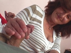 His dick fucks the mature slut hard and she loves how he can't move because of the cuffs