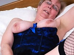 Naughty matue slut playing with her pussy