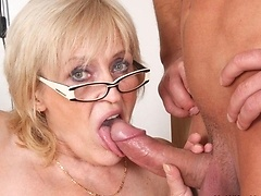 Hot mature slut loves porn and makes a little right here with a younger man