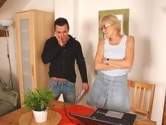 His throbbing young cock fucks the granny after he sets up her laptop and finds porn