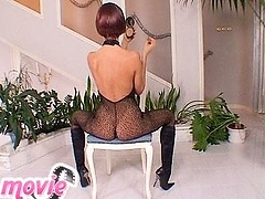 Horny sexbomb Sandy toying with a huge glass dildo