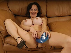 Super hot MILF has big fake tits and knows how to use them!