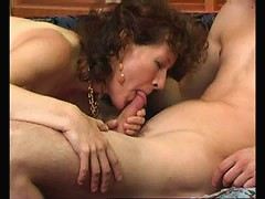 Mature brunette gives her young fuckmate a blowjob