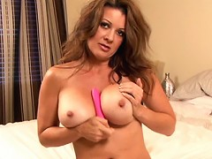 Horny older chick Raquel shows off her big tits and rubs her pussy for you.